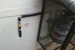 Electrical Installations installed a 9kg gas bottel in a cage on a Elba gas stove in Camelia street Brakpan 04